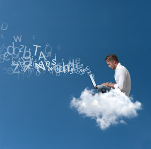 Businessman works over a cloud-hq